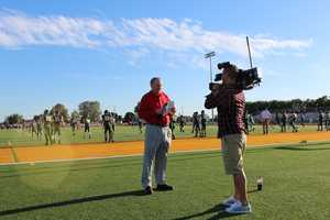 Hall of Fame Chiefs Super Bowl champion quarterback Len Dawson delivers a sideline report during pregame. This week marks Dawson's 49th year with KMBC-TV.