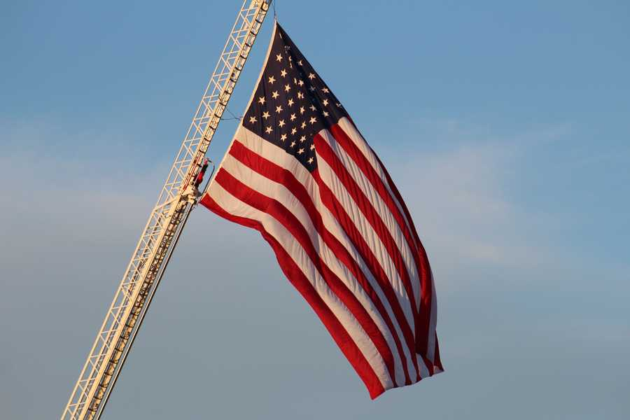 The Basehor-Linwood Bobcats hosted the Lansing Lions Friday night.  A moment of silence was held before the game to remember the victims of September 11, 2001.  The fan section of both teams proudly showcased the red, white and blue.  A fire truck with the Fairmount Township Fire Department displayed an American flag on a 105 foot ladder at the game's entrance.
