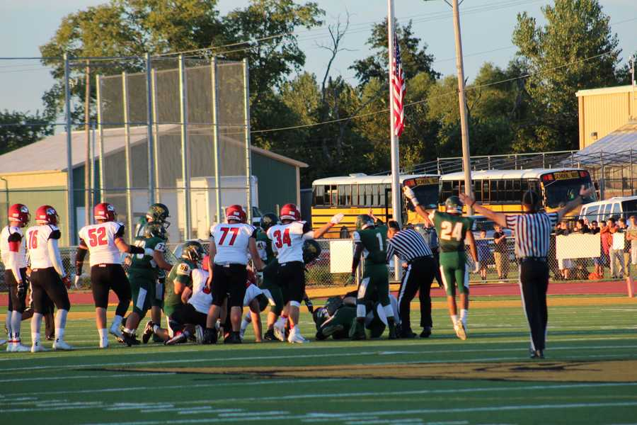 The home team Basehor-Linwood Bobcats took a 14-0 first half lead.  Both teams turned the ball over, but Bobcats quarterback Justin Phillips capitalizes with two touchdowns.