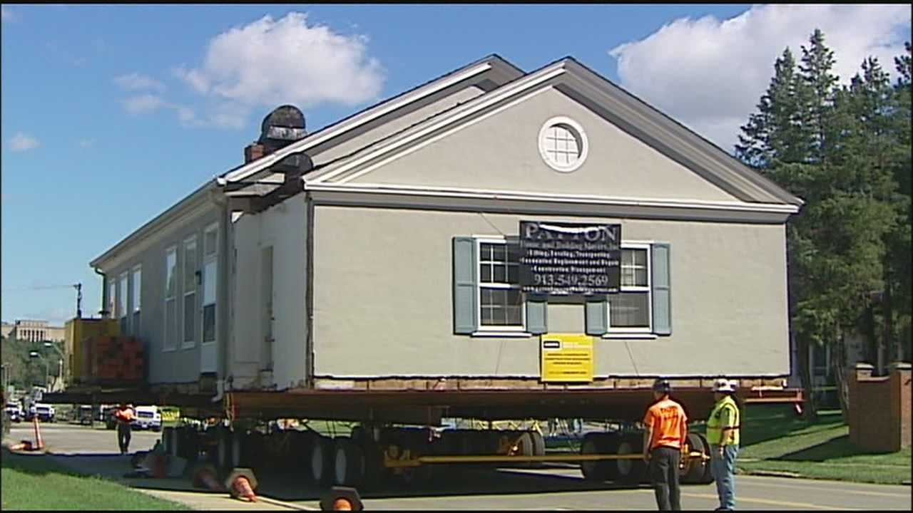 A historic clubhouse at the University of Missouri at Kansas City is moved to its new location Saturday.