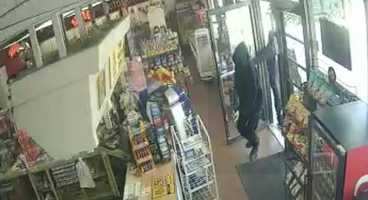 Police released photos from Sunday's robbery at the Minute Stop convenience store near 103rd Street and Marty.