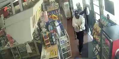 Three men, two of whom had guns, came into the store early Sunday afternoon and robbed the clerk.