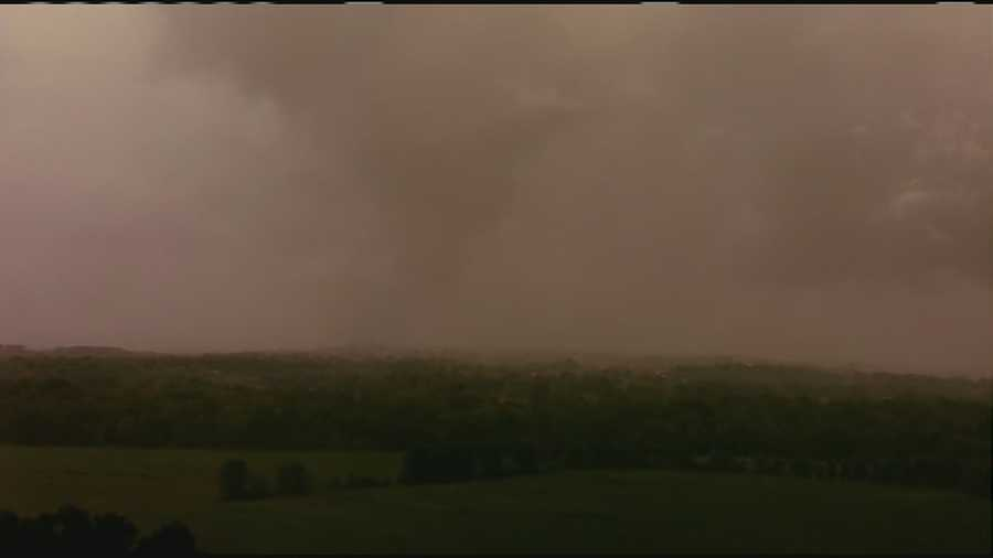 KMBC's Johnny Rowlands in NewsChopper 9 spotted a tornado touching down near Freeman, Missouri at 7:12 p.m.