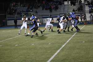 Quarterback Anthony Pritzel drops back to throw a pass versus Harrisonville in the KMBC HyVee Game of the Week.