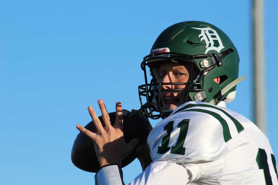 Quarterback Nate Thompson warms up before his DeSoto Wildcats spar with the Spring Hills Broncos.