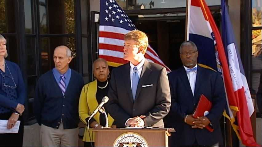 Missouri Attorney General Chris Koster, flanked by Kansas City Mayor Sly James, announces that a new assessment and triage center will open next year in Kansas City to alleviate a shortage of treatment spaces for those suffering from mental illness and substance abuse.