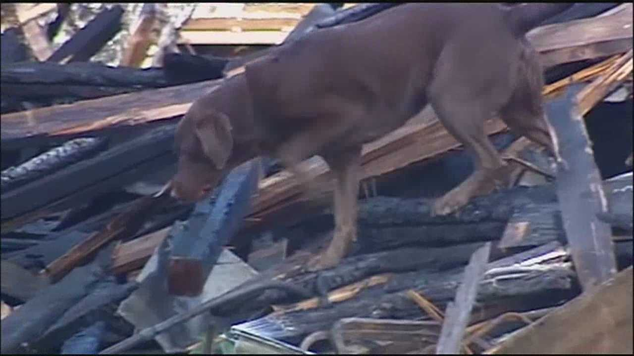 Investigators and cadaver dogs continue to comb through debris at the scene of Monday's building fire and collapse that killed two Kansas City firefighters and injured two others.