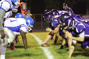 Running back Thomas San Agustin scored the first touchdown on a 30-yard scamper for Louisburg.