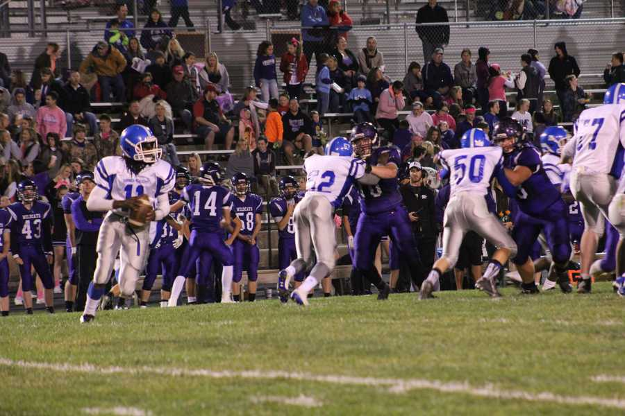 Freshman quarterback Nahshon Houston and the Sumner Academy offense try and move the ball against Louisburg's defense.