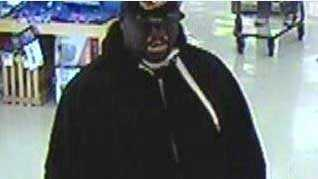 The FBI released a picture of a man suspected of robbing a bank Thursday inside a Prairie Village grocery store.