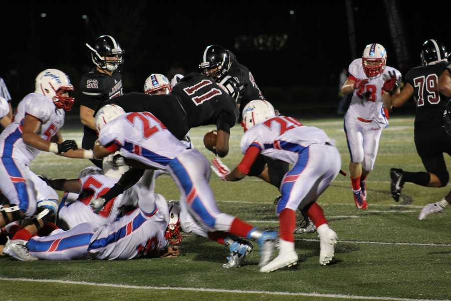 The defense of Olathe North stuffed Lawrence's run offense to regain possession late in the fourth quarter.