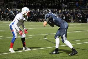 Bllue Valley North hosted Olathe North in a playoff game Friday night. The teams scored a combined 42 points in the first quarter and were tied, 21-21.