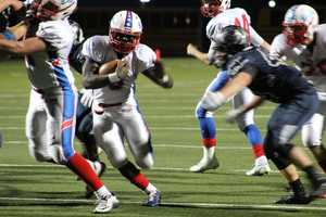Bllue Valley North hosted Olathe North in a playoff game Friday night. After trailing 28-21 at halftime, Vinnie Shabazz scores for Olathe North. The Eagles would miss the extra point and trail 28-27.