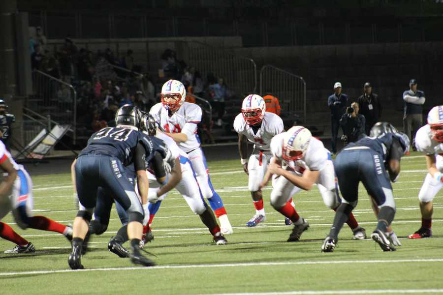 Olathe North quarterback Matt Wright scrambled during an important fourth quarter drive for the Eagles.