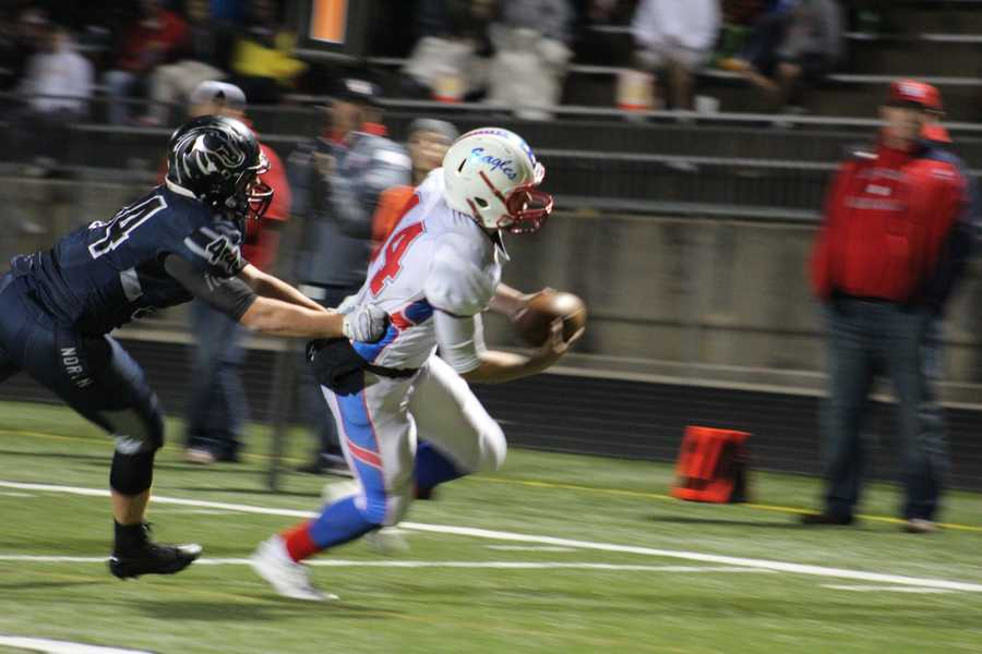 Olathe North quarterback Matt Wright scrambled during an important fourth quarter drive for the Eagles. Wright scored on this play with about 4 minutes left in the game.  The Eagles led 35-28.