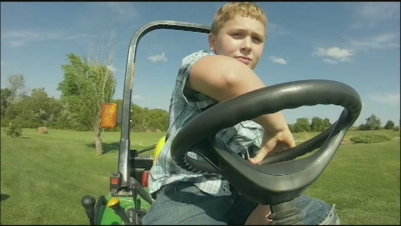 A boy who lost both of his legs after falling off a riding lawnmower offering an inspirational example of how to recover from a major setback.