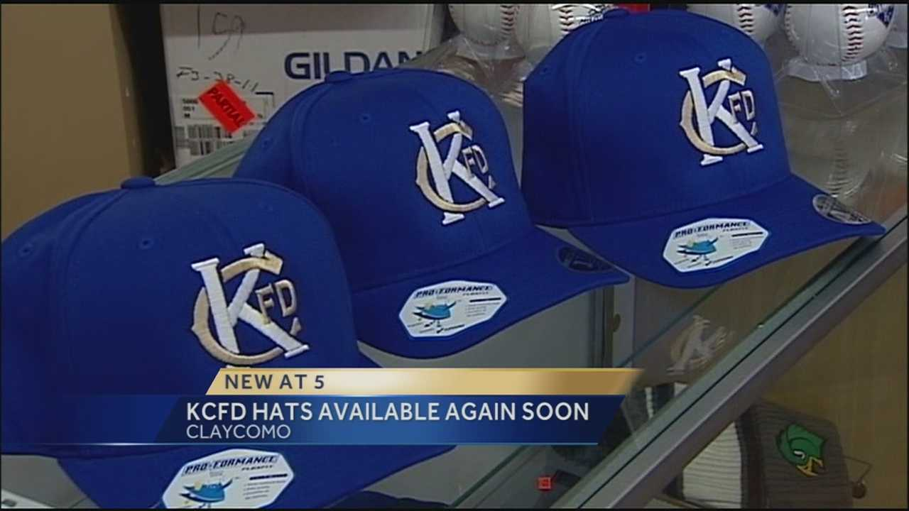 The owners of a T-shirt shop that sold tribute hats in memory of two Kansas City firefighters turns over more than $70,000 to the men's families.