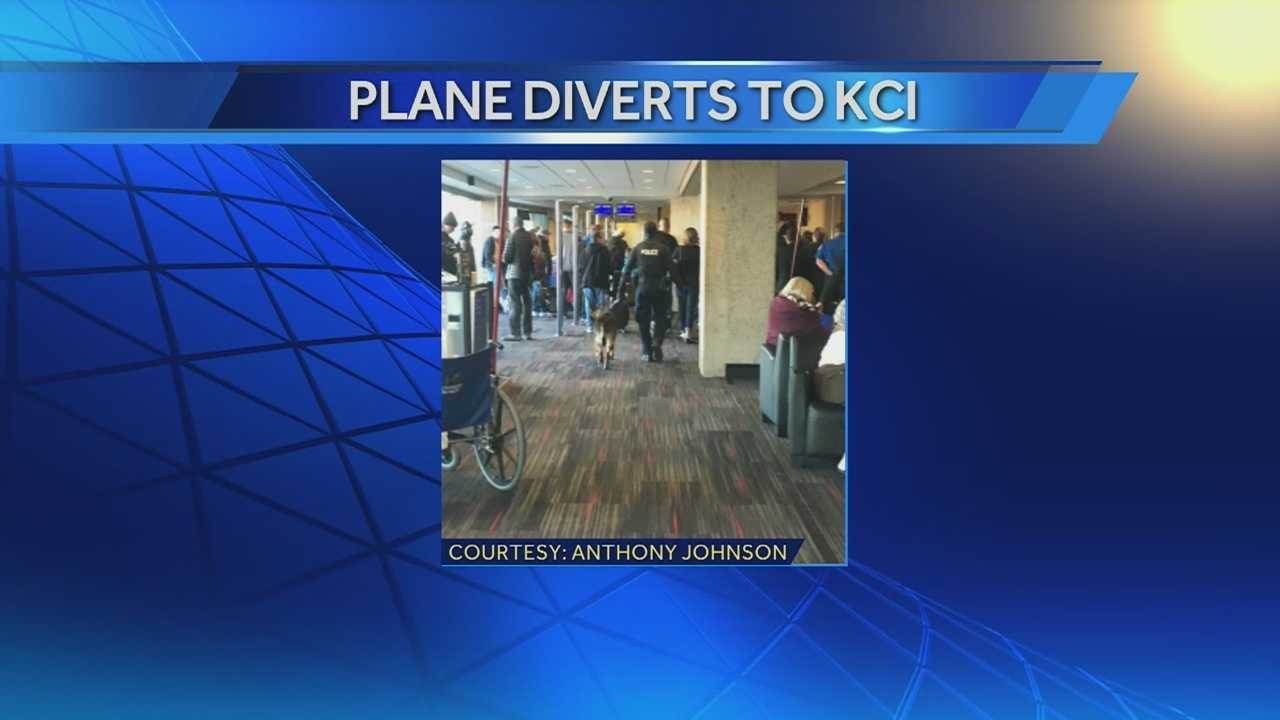 A Southwest Airlines plane on the way from Indianapolis to Los Angeles stops in Kansas City because of the behavior of some of the passengers. Those passengers were questioned and later let go.