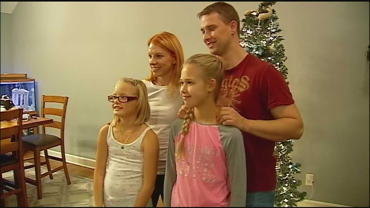 A father and his daughters are back together and preparing for the holidays after a custody dispute that took them to the other side of the world.
