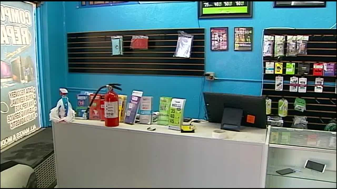 The owner of a northeast Kansas City electronics and a worker wrestle a would-be thief until police arrive.