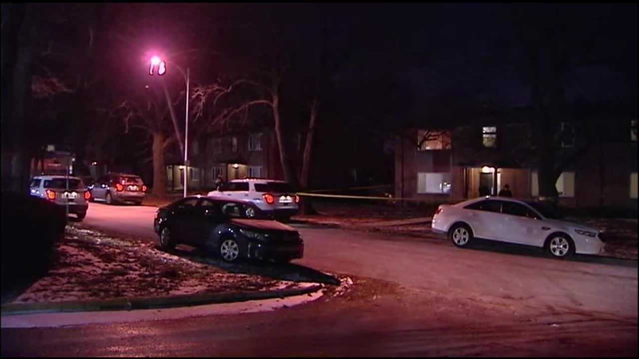 Police said a woman was killed in an apartment in Overland Park and a man has been taken in for questioning.