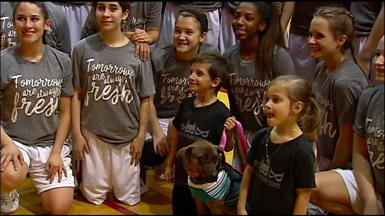 Some Kansas high school basketball players are rooting for a 6-year-old boy who's battling a series of illnesses.