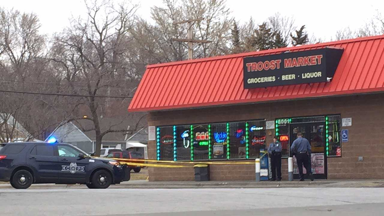 Kansas City police cordon off an area near Troost Market Tuesday morning after a shooting victim goes to the store for help. Authorities believe the man was shot a block away.