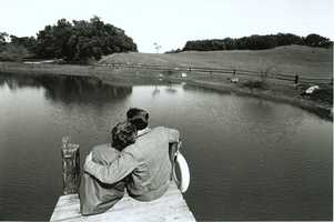 With the pressures of the White House put aside for a few minutes, President and Mrs. Reagan sit on the dock overlooking Lake Lucky at Rancho del Cielo in Santa Barbara, California. (March 4, 1982)