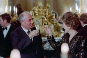 During the Washington Summit, First Lady Nancy Reagan and the General Secretary Mikhail Gorbechev toast at the Soviet Embassy Dinner. (December 9, 1987)