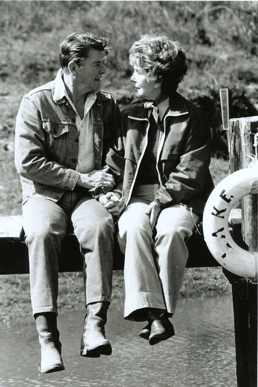 President Ronald Reagan and First Lady Nancy Reagan enjoy each other's company on the dock overlooking Lake Lucky at Rancho del Cielo in Santa Barbara, California, (March 4, 1982)