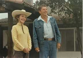 President Ronald Reagan and First Lady Nancy Reagan enjoy their time away from Washington in front of their ranch house at Rancho del Cielo in Santa Barbara, California, (August 13, 1981)