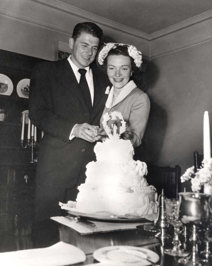 Newlyweds Ronald and Nancy Reagan cut their wedding cake. (March 4, 1952)