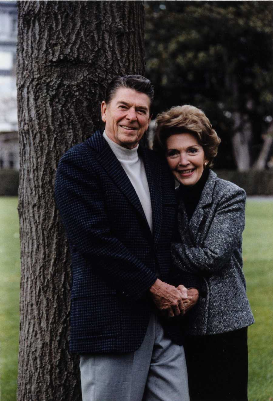 President and First Lady Ronald and Nancy Reagan pose for a casual official portrait on the White House South Lawn (Nov. 22, 1981)