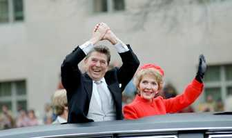 President Ronald Reagan and First Lady Nancy Reagan wave from the limousine during the Inaugural Parade (Jan. 20, 1981)