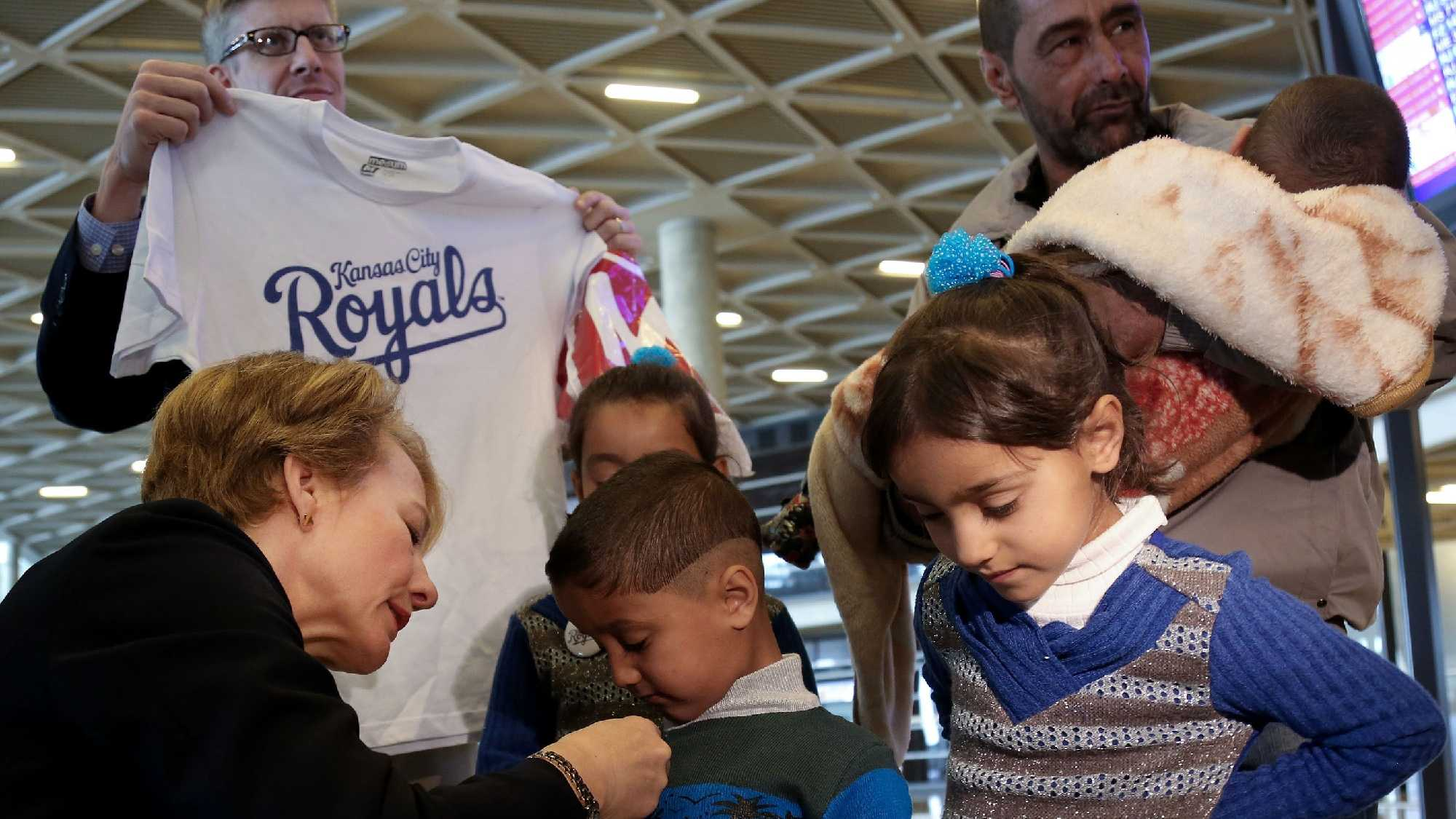 "U.S. Ambassador to Jordan Alice Wells meets with Syrian refugee Ahmad al-Abboud, top right, and his family at the International Airport of Amman, Jordan, Wednesday, April 6, 2016. The first Syrian family to be resettled to the U.S. under its speeded-up ""surge operation"" departed to the United States Wednesday from the Jordanian capital, Amman. Al-Abboud, who is being resettled with his wife and five children, said that although he is thankful to Jordan — where he has lived for three years after fleeing Syria's civil war — he is hopeful of finding a better life in the U.S. (AP Photo/Raad Adayleh)"