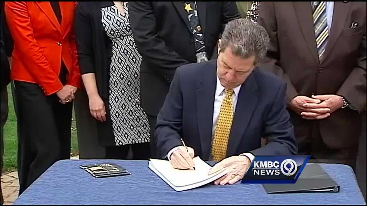 Kansas Gov. Sam Brownback said he hopes a new law will help fix the state's troubled juvenile justice system, a system that many lawmakers felt was doing more harm than good.