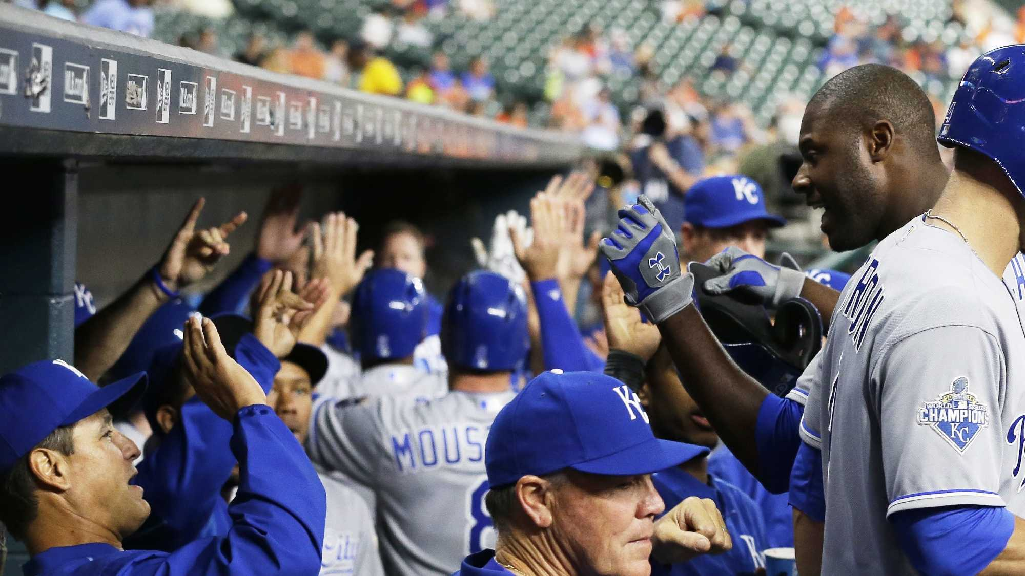 Kansas City Royals' Lorenzo Cain, right, is welcomed back to the dugout after hitting a three-run home run against the Houston Astros during the first inning of a baseball game Tuesday, April 12, 2016, in Houston. (AP Photo/Pat Sullivan)