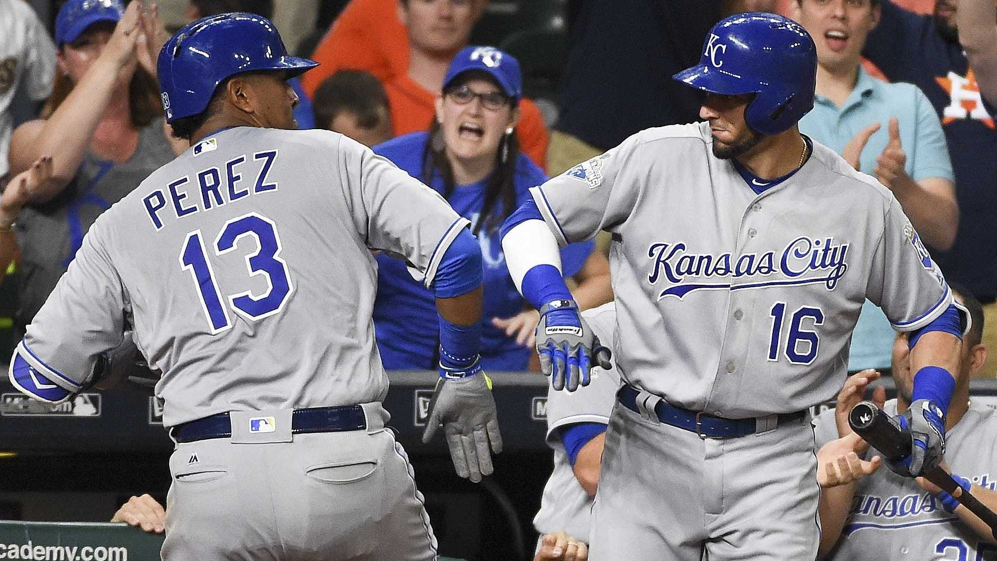 Kansas City Royals' Salvador Perez (13) celebrates his two-run home run with Paul Orlando (16) in the eighth inning of a baseball game against the Houston Astros, Wednesday, April 13, 2016, in Houston. (AP Photo/Eric Christian Smith)