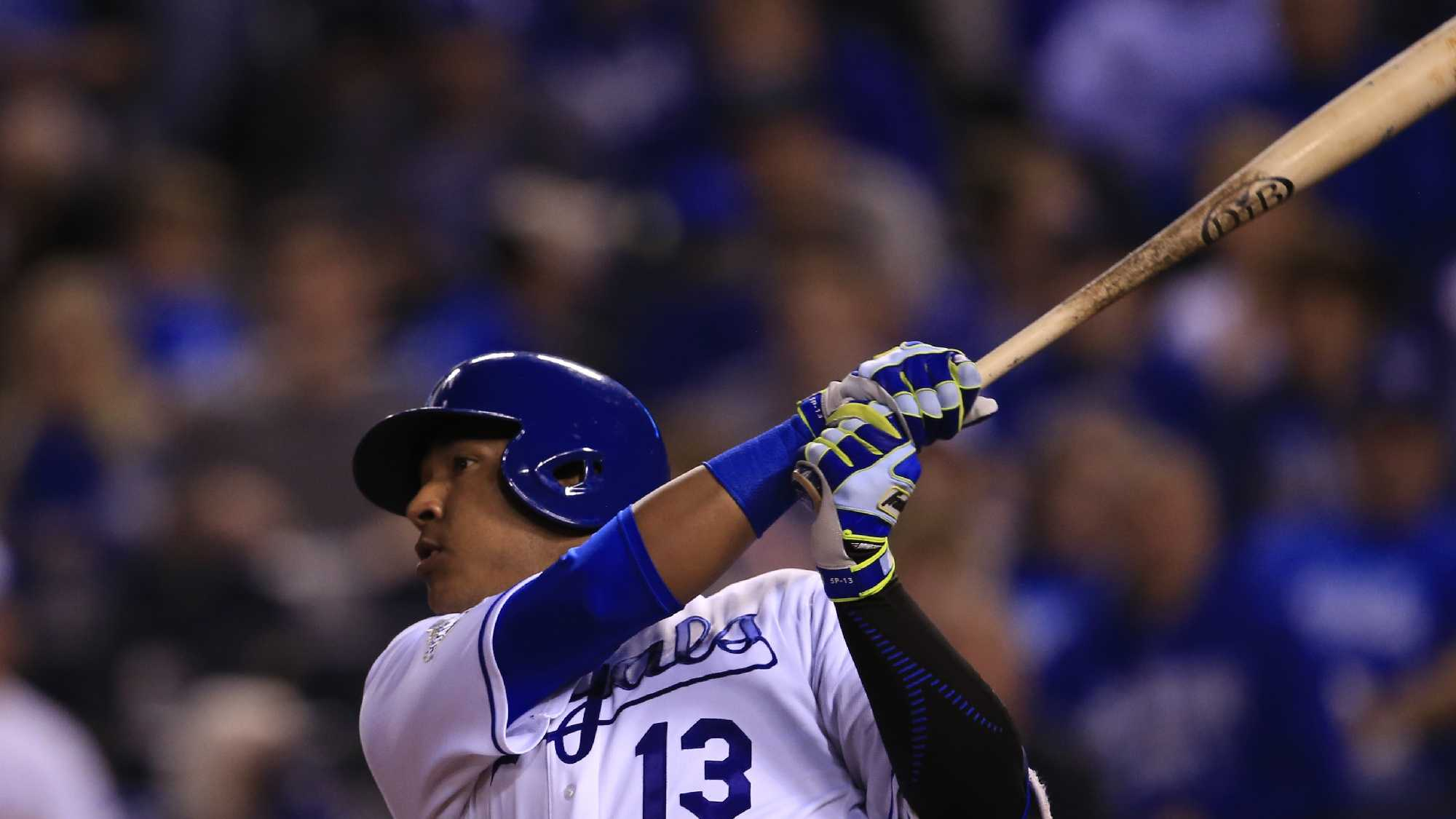 Kansas City Royals' Salvador Perez hits a three-run home run off Detroit Tigers relief pitcher Blaine Hardy (65) during the fifth inning of a baseball game at Kauffman Stadium in Kansas City, Mo., Tuesday, April 19, 2016. (AP Photo/Orlin Wagner)