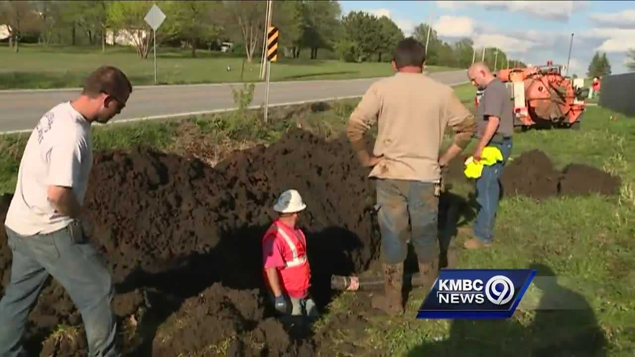 Crews installing a fiber line in Louisburg, Kansas, Wednesday mistakenly cut into a water main.