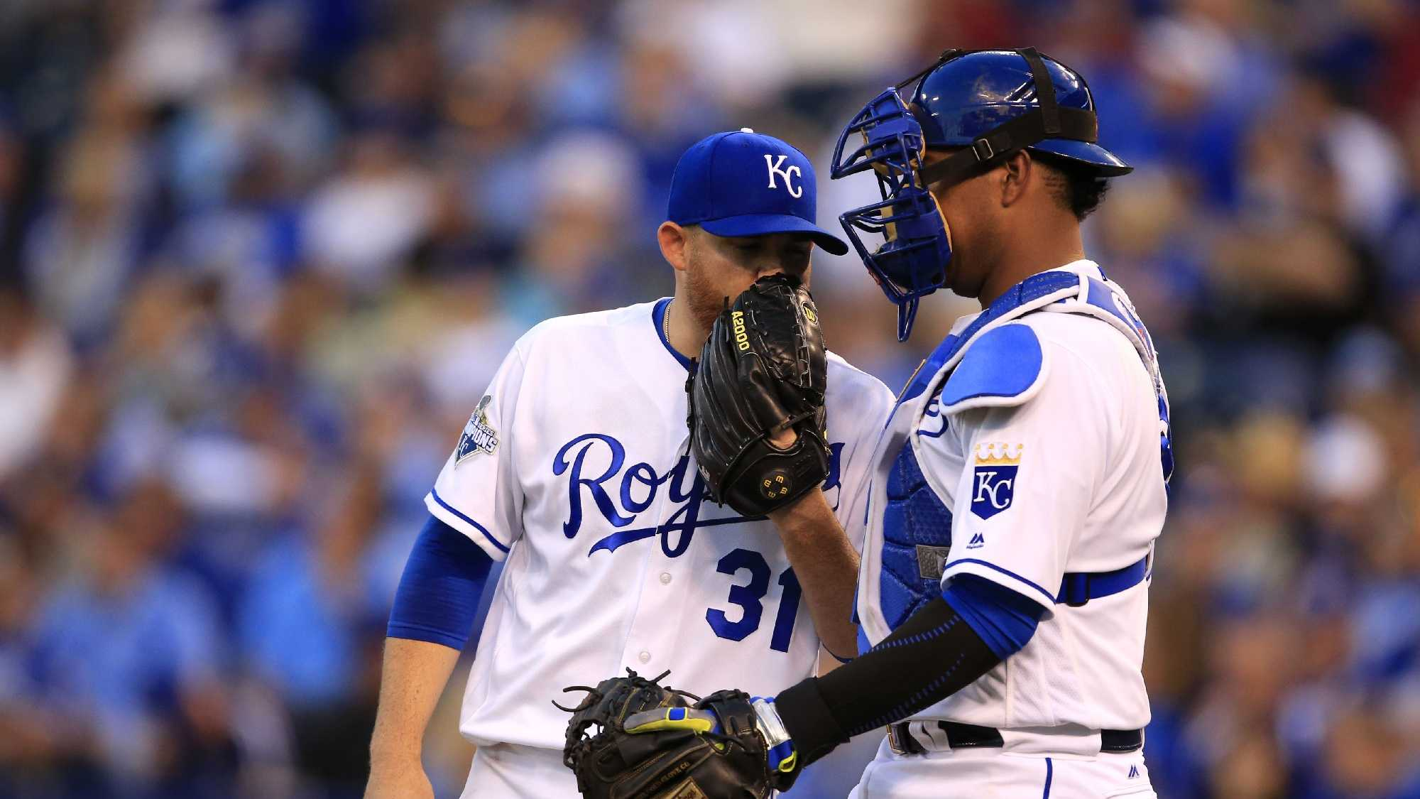 Kansas City Royals starting pitcher Ian Kennedy (31) and catcher Salvador Perez during a baseball game against the Detroit Tigers at Kauffman Stadium in Kansas City, Mo., Wednesday, April 20, 2016. (AP Photo/Orlin Wagner)