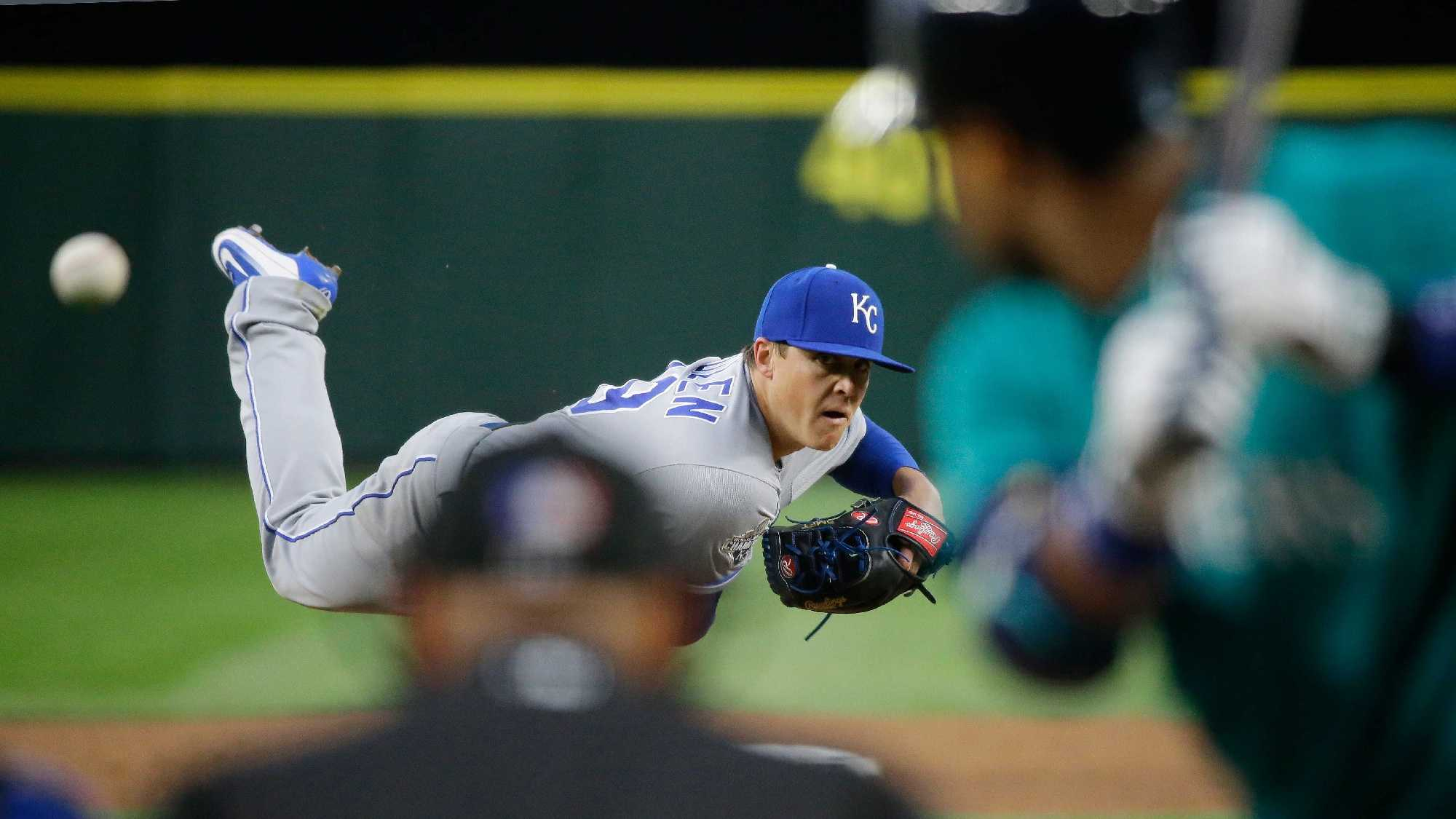 Kansas City Royals starting pitcher Kris Medlen throws against the Seattle Mariners in the third inning of a baseball game, Friday, April 29, 2016, in Seattle. (AP Photo/Ted S. Warren)