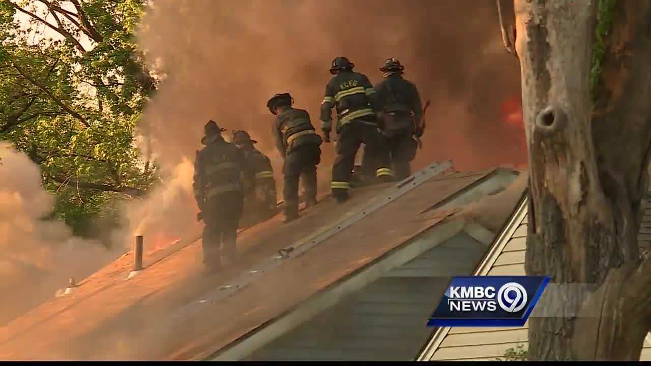 Firefighters worked to put out a large fire at a home in east Kansas City Tuesday evening.