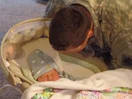 This is Rowan - Rob's younger son. Rob missed Rowan's birth because he was out of state on a 7-month military training deployment. Rob met Rowan for the first time (pictured here) after being allowed to come home on emergency leave. Rowan will turn 1 in May.