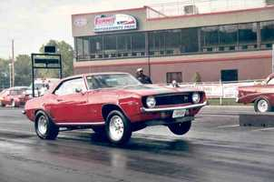 If Rob could afford any car in the world, he'd buy a 1969 Chevy Camaro Z28 SS/RS, red with two fat black racing stripes, 4 on the floor, 454 custom engine with 500+ horsepower that can run a ¼ mile in 8 seconds.