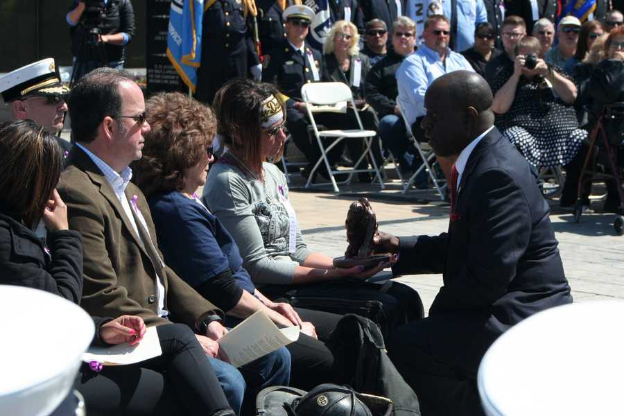 A proclamation from Gov. Jay Nixon and a fallen firefighter statue are presented to the family of Larry Leggio.