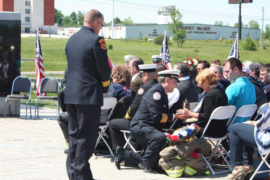 The family of firefighter Larry Lawhorn is presented with a proclamation from Gov. Jay Nixon and a fallen firefighter statue.