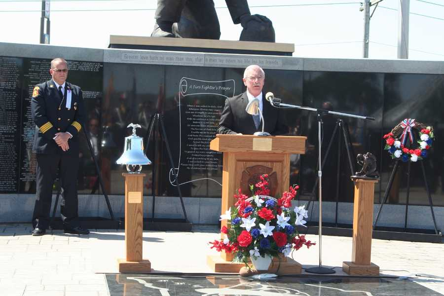 Department of Public Safety Director Lane Roberts reads a proclamation from Gov. Jay Nixon.