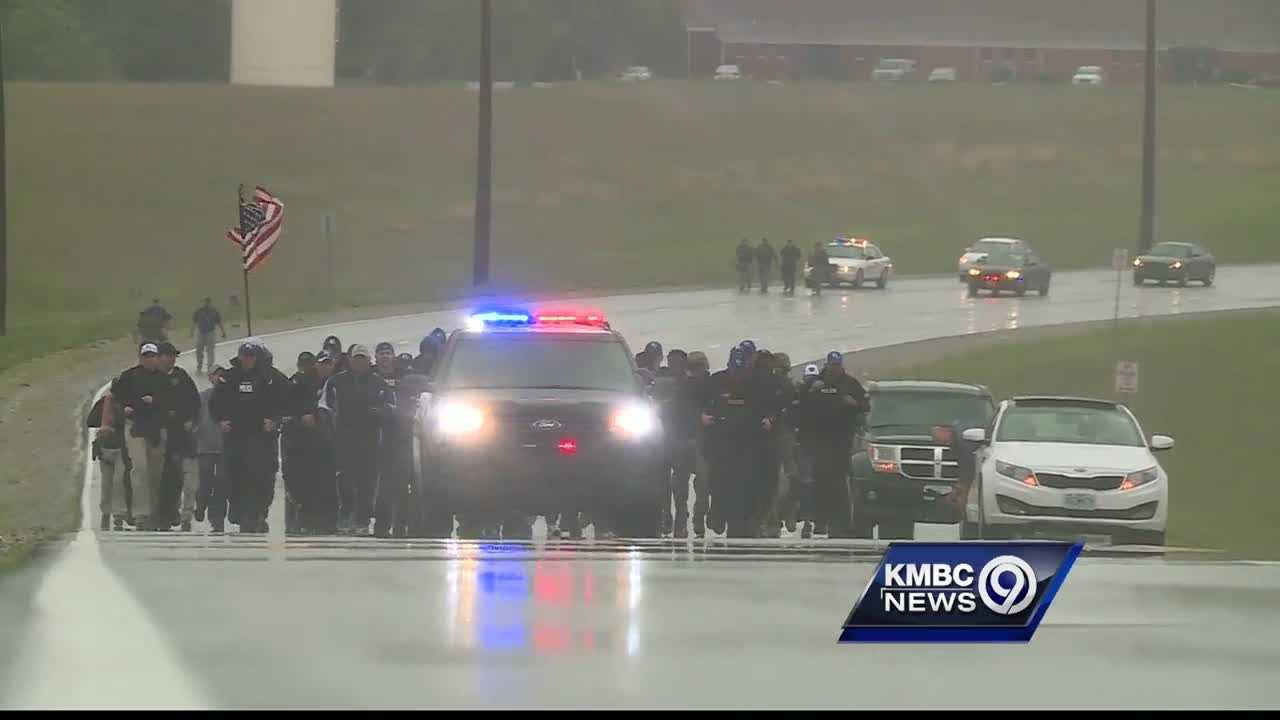 Dozens of members of the Kansas City, Kansas, Police Department and other departments from the area decide to run in full tactical gear in memory of Detective Brad Lancaster.