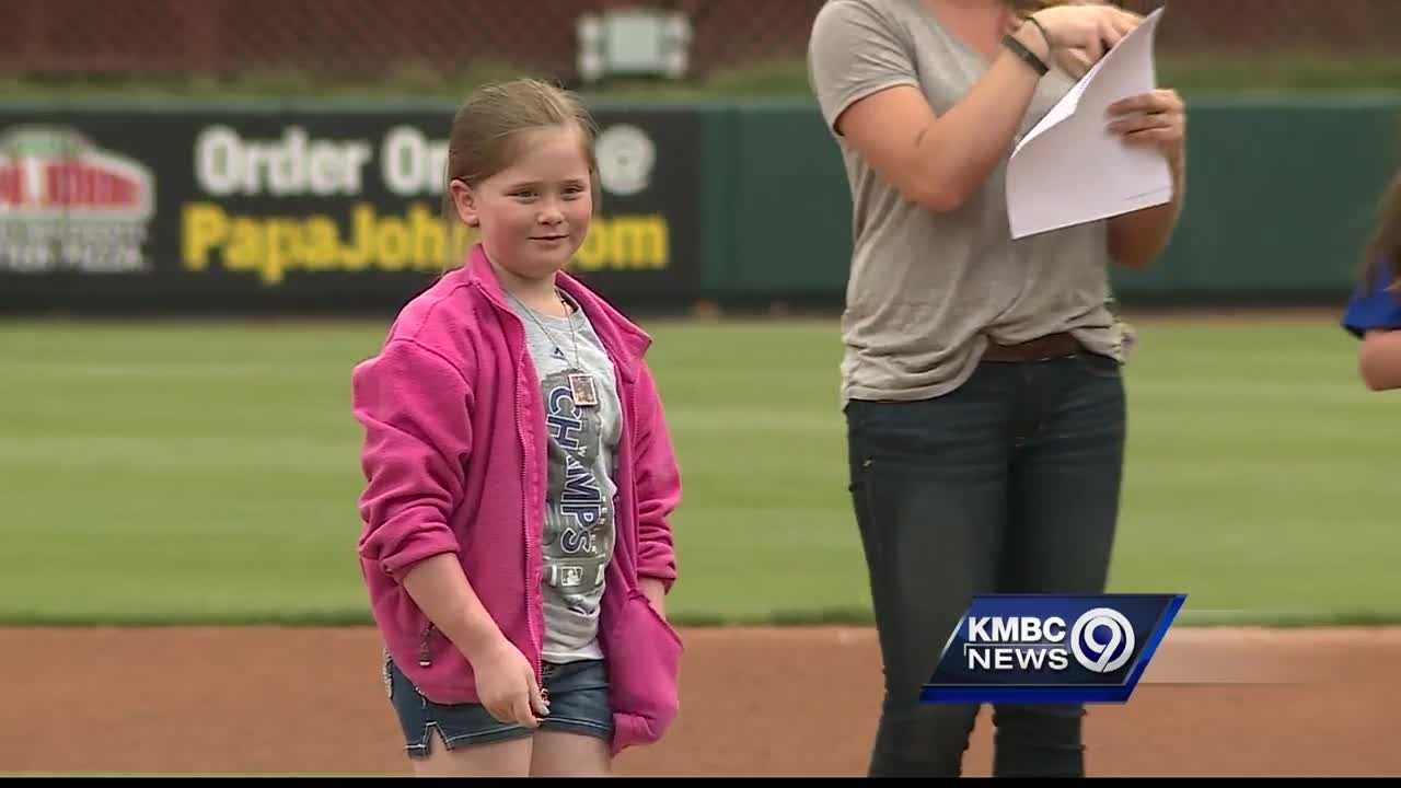 The daughters of slain Kansas City, Kansas, police Detective Brad Lancaster are recognized before Thursday's Kansas City T-Bones game.